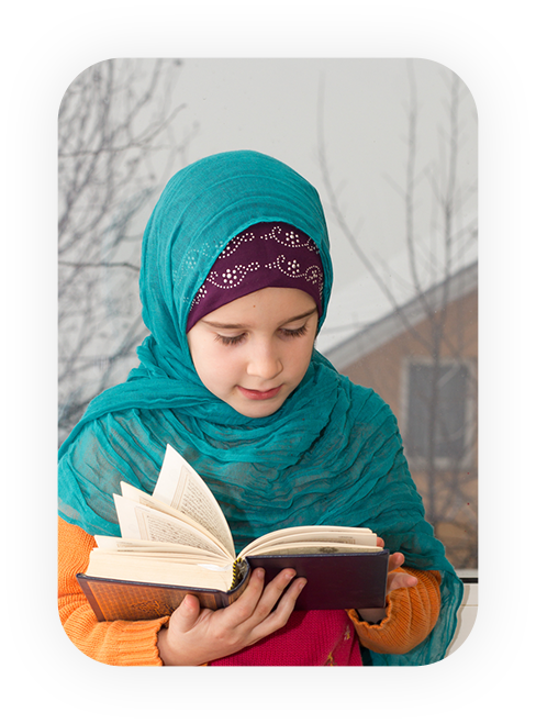 kid reading quran outside